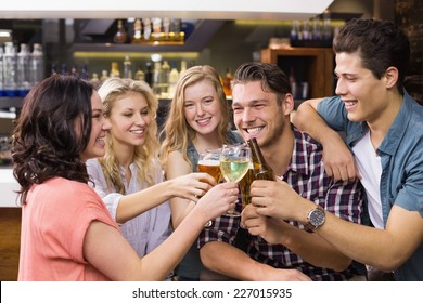 Young friends having a drink together at the bar