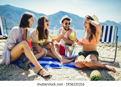 Young friends having fun at the beach on a sunny day. Party time.