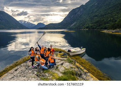 Young friends having fun on the picnic on the island of Norway