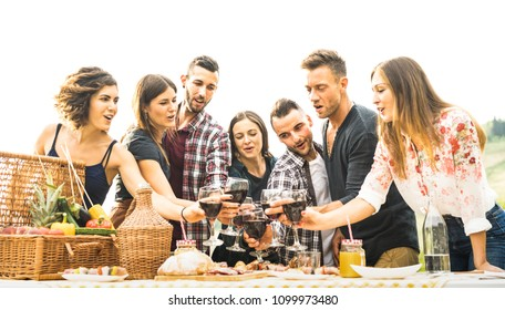 Young friends having fun outdoors drinking red wine at barbecue - Happy people eating healthy food at harvest time in farmhouse vineyard winery - Youth friendship concept on warm vintage filter