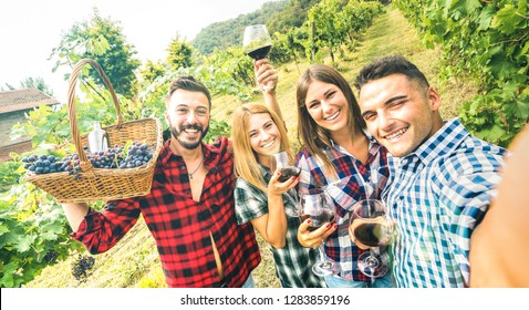 Young friends having fun taking selfie at winery vineyard outdoor - Friendship concept on happy people enjoying harvest together at farm house - Red wine bio production experience - Azure vivid filter