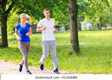 Young friends jogging in the city park