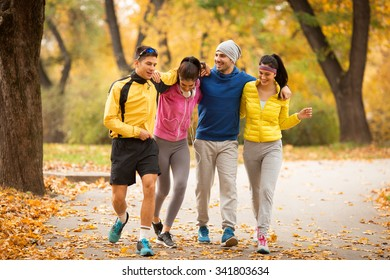 Young friends jogging at the park.Autumn season.