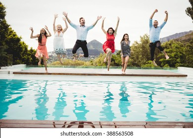 Young friends and jumping in the swimming pool