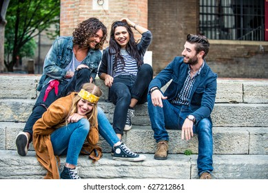 Young friends sitting on staircase having fun