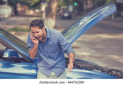 young frustrated angry man calling for car service screaming standing by broken car. Rude customer service bad road car assistance