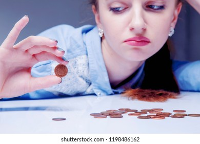 Young frustrated and desperate Woman counting small money