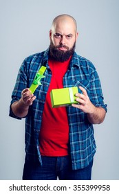 young frustrated man with green gift box