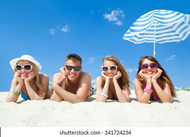 Young fun people are having good time on the beach