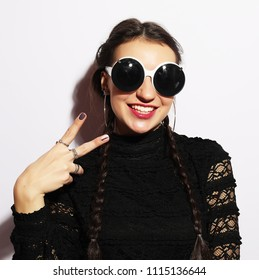 Young funny brunette  woman in big sunglasses. Fashion concept.