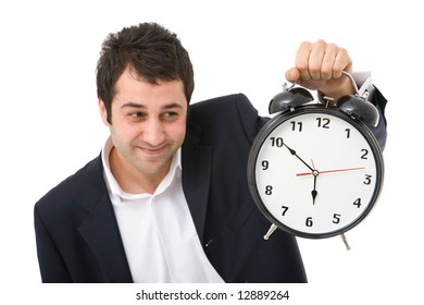 young funny businessman with an alarm clock on white background