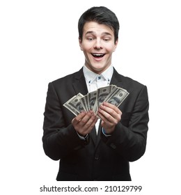 young funny caucasian businessman in black suit holding money isolated on white