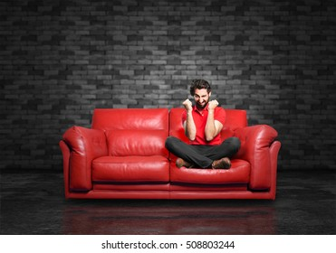 young funny man angry pose sitting down.