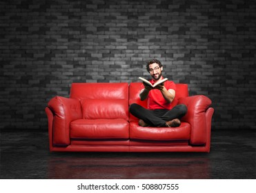 young funny man with book, sitting down.