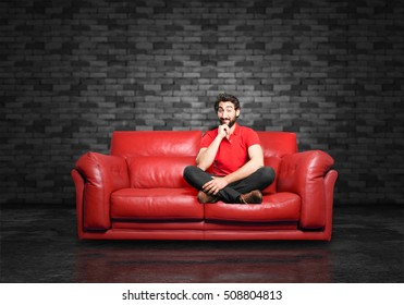 young funny man having an idea sitting down.