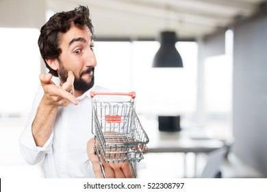 young funny man with shopping cart