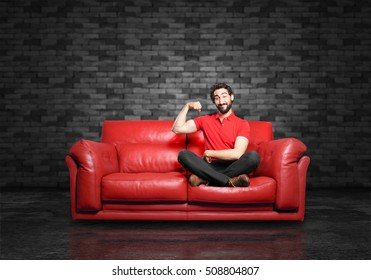 young funny man strong pose sitting down.
