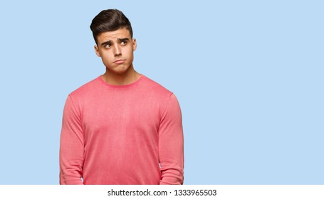 Young funny man thinking about an idea