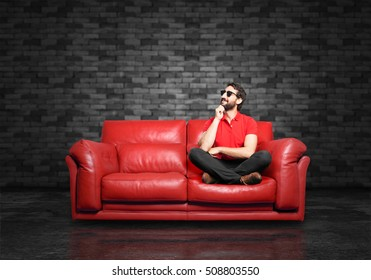 young funny man thinking sitting down.
