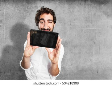 young funny man with touch screen tablet