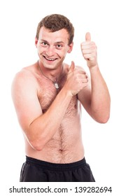 Young funny shirtless man showing thumbs up, isolated on white background