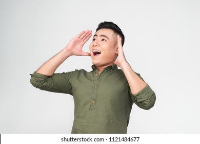 Young funny shouting men holding his head in hands on white background. Stress concept for young generation
