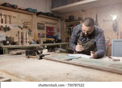 Young furniture designer in workshop.