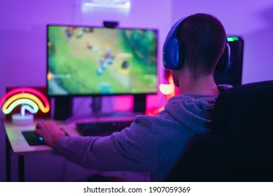 Young gamer playing online video games while streaming on social media - Youth people addicted to new technology game