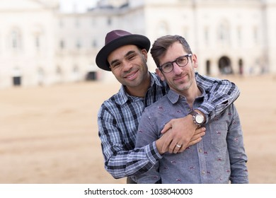 young gay couple hugging each other