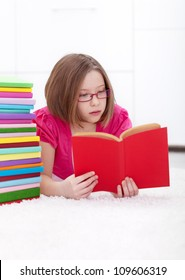 Young girl absorbed by a good book - reading and learning concept