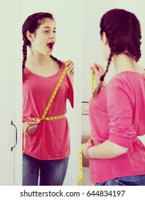 Young girl achieving success with weight loss at home