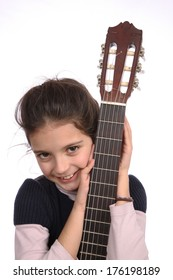 Young girl with an acoustic guitar on a white background