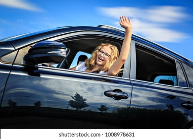 a young girl after successfully driving exam in a car