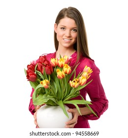 Young girl against white background holding tulips bouquet and smiling at camera