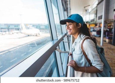 Young girl at airport waiting for plane