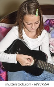 A young girl alone with her thoughts and music.