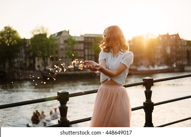Young girl in amazing dress posing in the street in Amsterdam. Amsterdam city, moods happy.