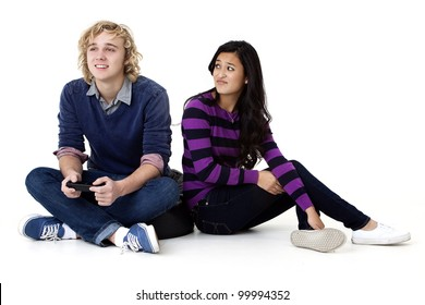 Young girl annoyed at her video game playing boyfriend