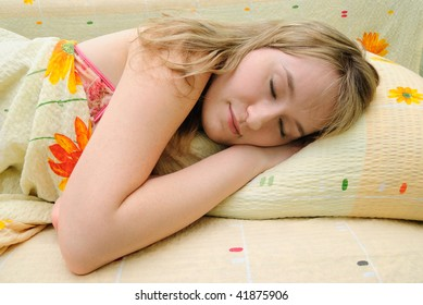Young girl asleep in her bed