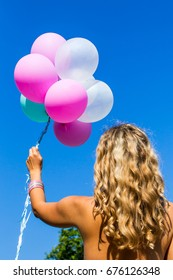 Young girl background holding balloons