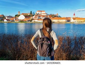 Young girl with backpack at Ptuj Castle and old town at Drava River in Slovenia. Architecture in Slovenija. Travel