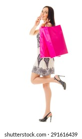 Young girl with bags and mobile phone isolated