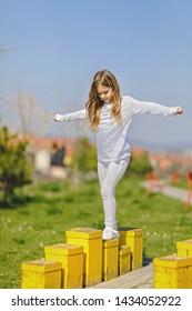 Young girl balancing at playground. Balancing concept.