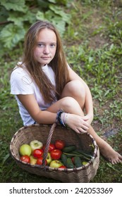 Young girl with basket of vegetables.