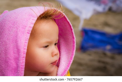 Young girl at the beach after a bath with various expressions
