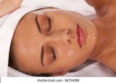 Young girl with beads of perspiration in SPA center.