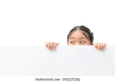 Young girl with beautiful eyes peeking over white corrugated plastic board, copy space with banner and advertising for input text concept.