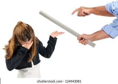 Young girl being physically punished by teacher with a ruler
