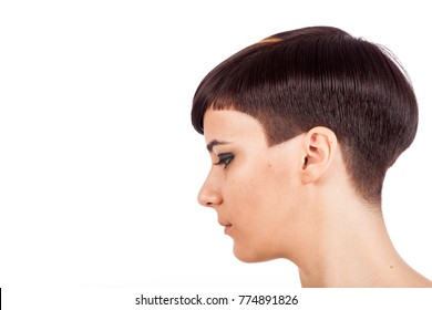 Young girl with bicolor pixie short hairstyle. Horizontal studio portrait with negative space.  Profile on white background.