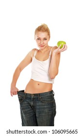 young girl with big jeans and apple, isolated on white background